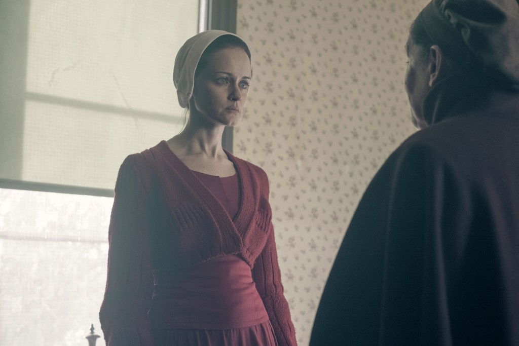 "This image released by Hulu shows Alexis Bledel in a scene from ""The Handmaid's Tale."" Bledel was nominated Thursday for an Emmy for outstanding suppo"