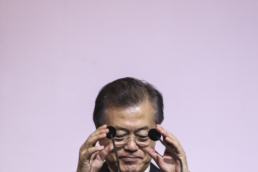 South Korea's President Moon Jae-in adjusts the microphones prior to delivering the 42nd Singapore Lecture organized by the Institute of South East As