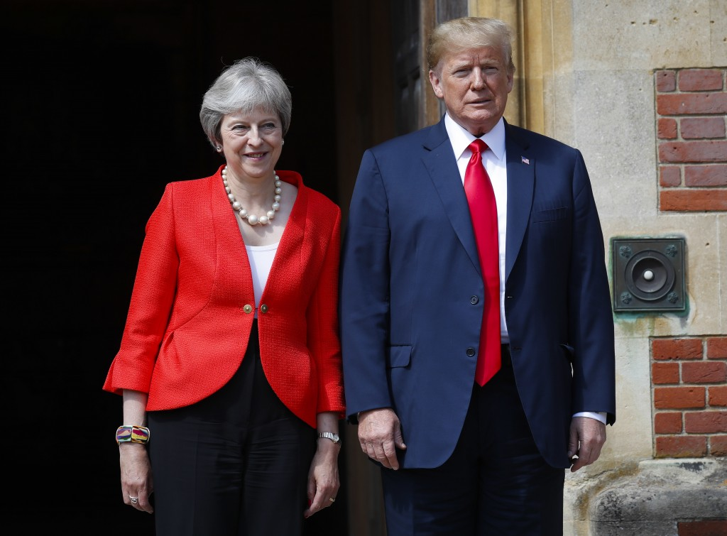 U.S. President Donald Trump with British Prime Minister Theresa May pose for photographers at Chequers, in Buckinghamshire, England, Friday, July 13,