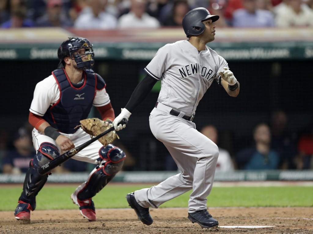 New York Yankees' Aaron Hicks watches his RBI double off Cleveland Indians starting pitcher Corey Kluber during the eighth inning of a baseball game,
