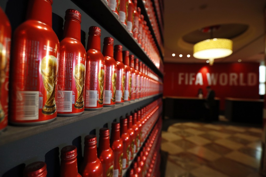 In this July 5, 2018 photo, Budweiser World Cup bottles line a wall in the lobby of the InterContinental Hotel, which has been taken over by Bud for t