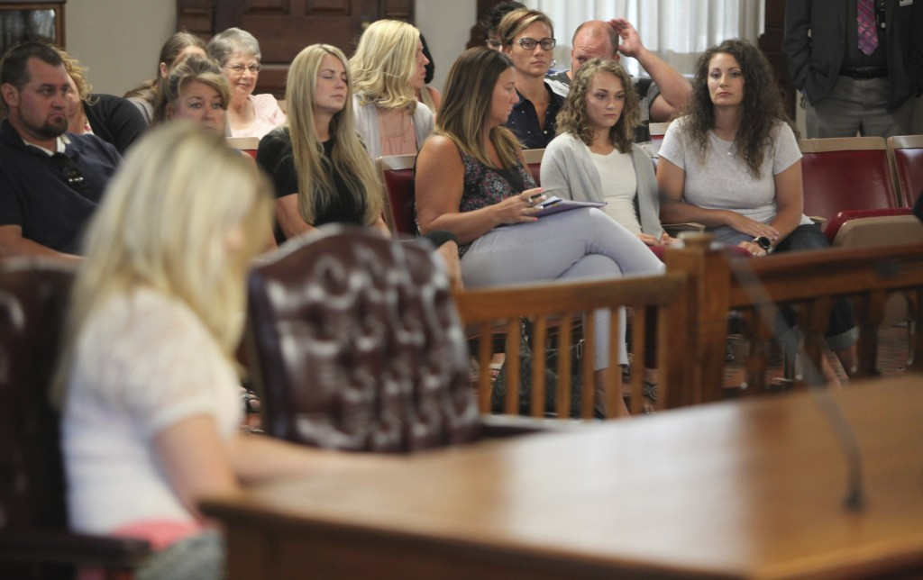 In this Wednesday, July 11, 2018, Kellie Cooke, right, looks at Tara (Lambert) Arbogast, left, foreground, as she appeared in Pickaway County Common P