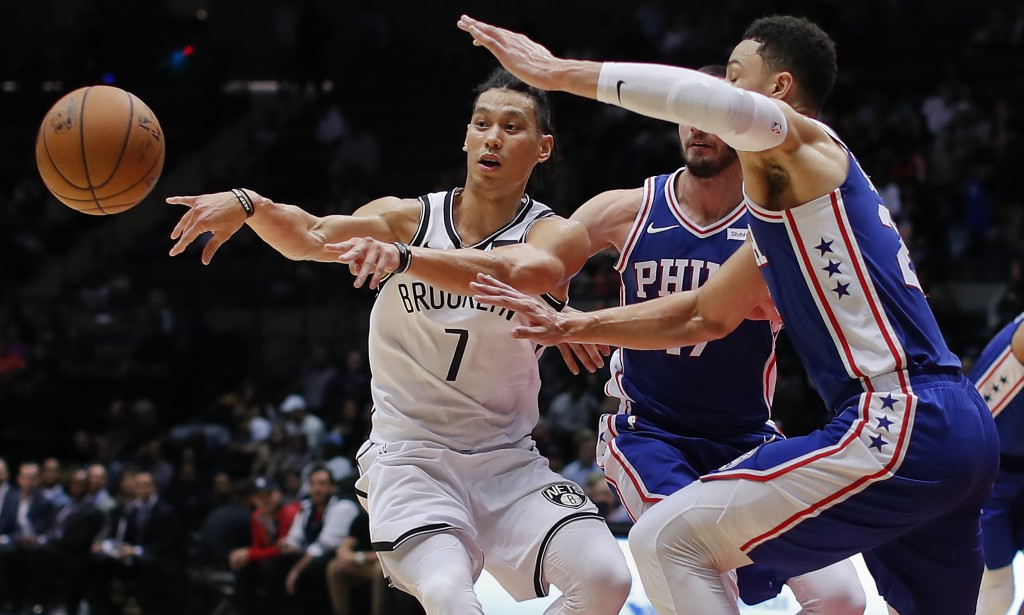 FILE - In this Oct. 11, 2017, file photo, Brooklyn Nets guard Jeremy Lin (7) passes the ball as Philadelphia 76ers guards Ben Simmons, right, and JJ R