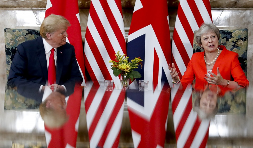 U.S. President Donald Trump, left, with British Prime Minister Theresa May, right, during their meeting at Chequers, in Buckinghamshire, England, Frid