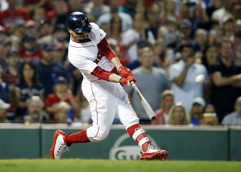 Boston Red Sox's Mookie Betts hits a grand slam during the fourth inning against the Toronto Blue Jays in a baseball game in Boston, Thursday, July 12