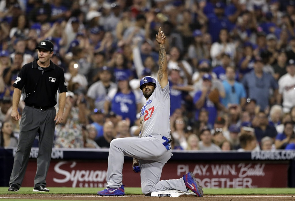 Los Angeles Dodgers' Matt Kemp gestures after reaching third from first on an RBI single by Joc Pederson during the seventh inning of a baseball game