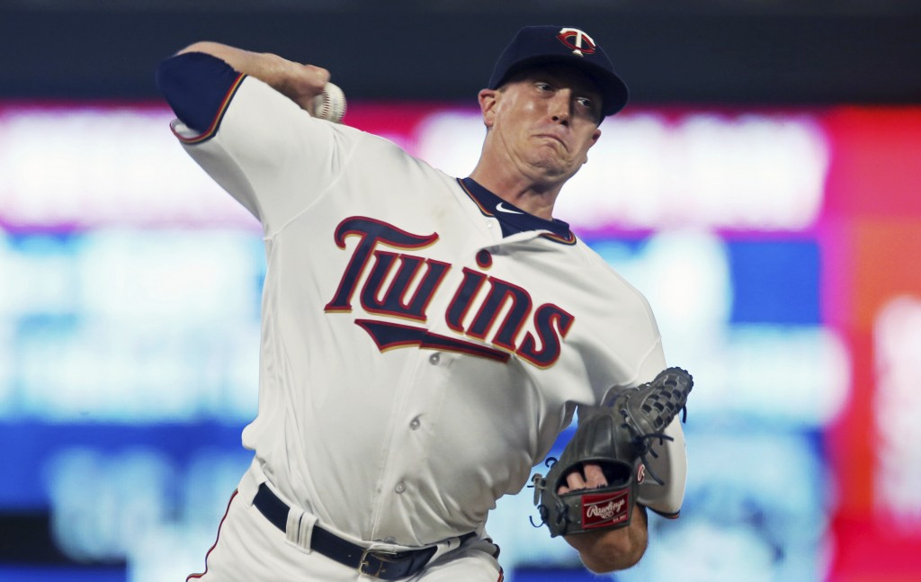 Minnesota Twins pitcher Kyle Gibson throws to a Tampa Bay Rays batter during the first inning of a baseball game Thursday, July 12, 2018, in Minneapol