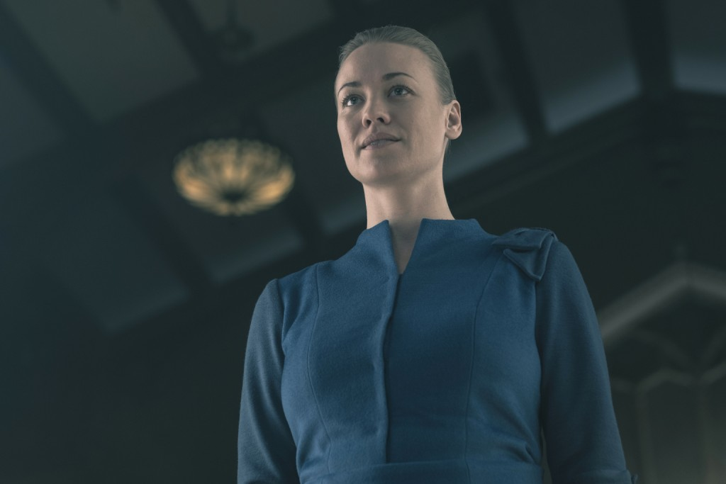 "This image released by Hulu shows Yvonne Strahovski in a scene from ""The Handmaid's Tale."" Strahovski was nominated Thursday for an Emmy for outstandi"