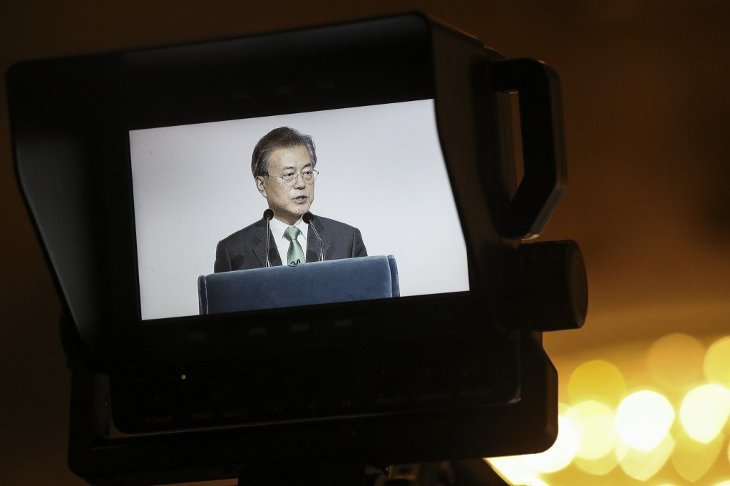 "South Korea's President Moon Jae-in is seen on a video screen as he delivers his speech entitled ""ROK and ASEAN: Partners for Achieving Peace and Co-p"