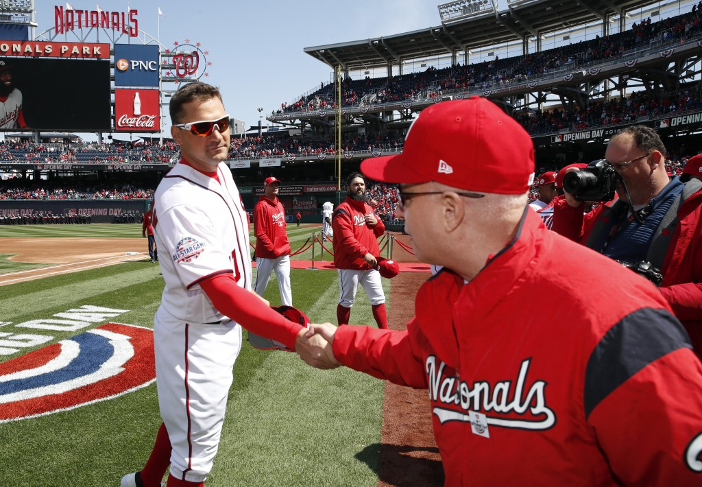 )FILE - In this April 5, 2018, file photo, Washington Nationals first baseman Ryan Zimmerman, left, shakes hands with Washington Nationals owner Mark