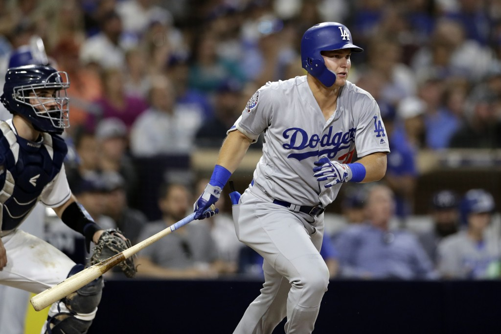 Los Angeles Dodgers' Joc Pederson watches his RBI single during the seventh inning of the team's baseball game against the San Diego Padres on Thursda