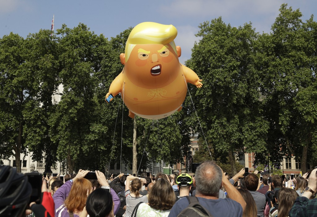 A six-meter high cartoon baby blimp of U.S. President Donald Trump is flown as a protest against his visit, in Parliament Square in London, England, F