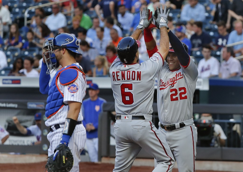 Washington Nationals' Anthony Rendon (6) is congratulated by Juan Soto after hitting a two-run home run against the New York Mets during the first inn