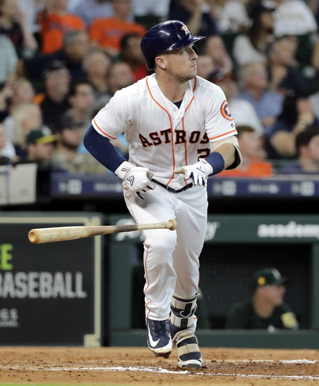 Houston Astros' Alex Bregman drops his bat after hitting a two-run double during the third inning of a baseball game against the Oakland Athletics Thu...