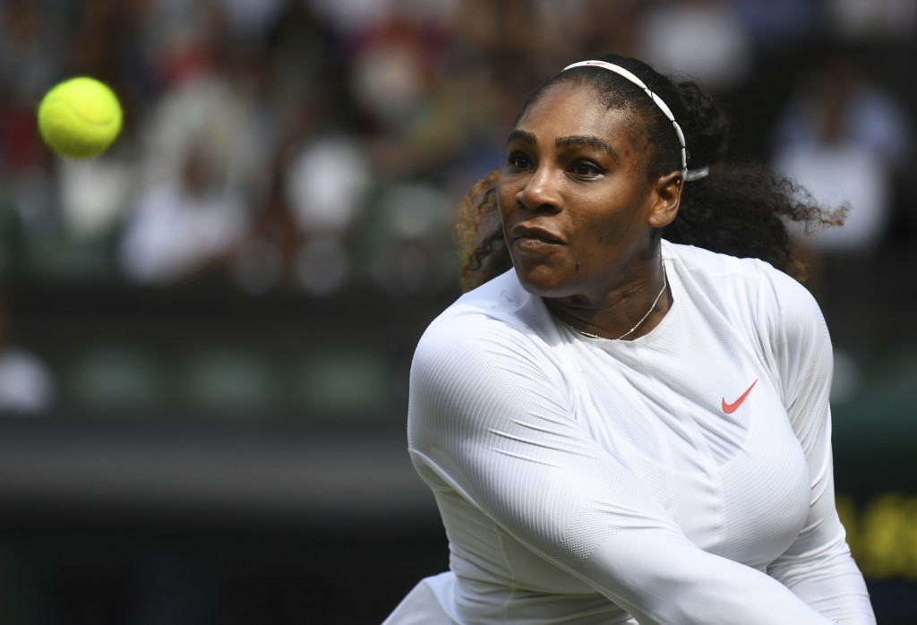Serena Williams of the US returns a ball to Julia Goerges of Germany during their women's semifinal match at the Wimbledon Tennis Championships in Lon