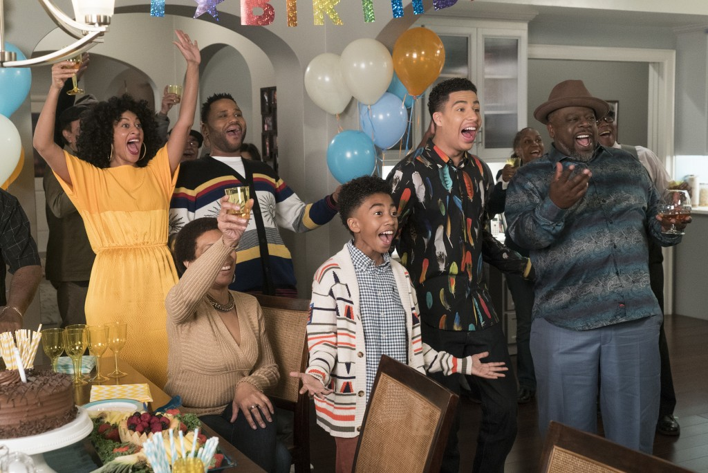 This image released by ABC shows, standing from left, Tracee Ellis Ross, Anthony Anderson, Miles Brown, Marcus Scribner and Cedric the Entertainer in
