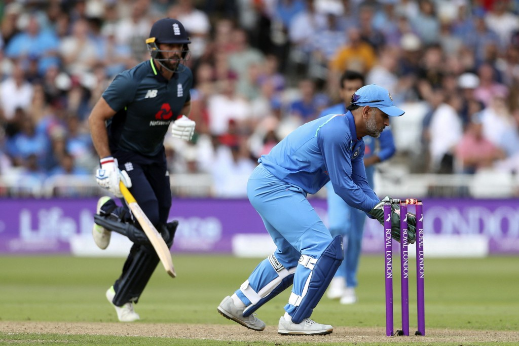 England's Liam Plunkett is run out by MS Dohni during the One Day International Series cricket match between England and India at Trent Bridge, Nottin