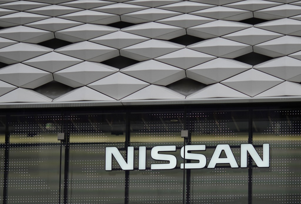 FILE- This June 14, 2018, file photo shows a Nissan logo at the automaker's showroom in Tokyo. Nissan is recalling nearly 105,000 small cars to replac