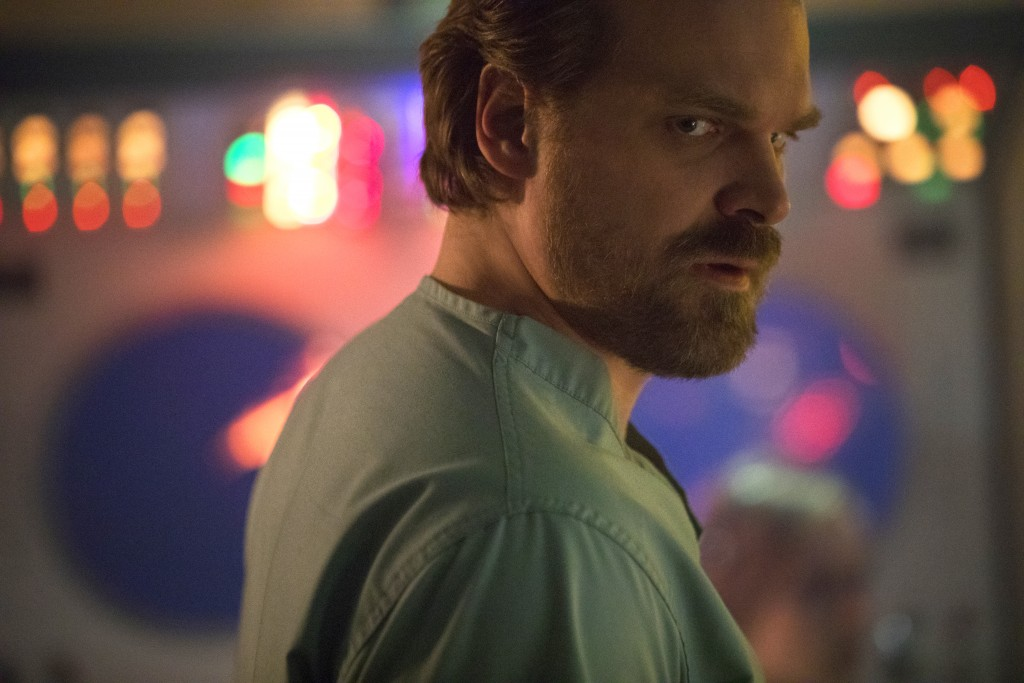 """This image released by Netflix shows David Harbour in a scene from """"Stranger Things 2."""" Harbour was nominated Thursday for an Emmy for outstanding sup"""