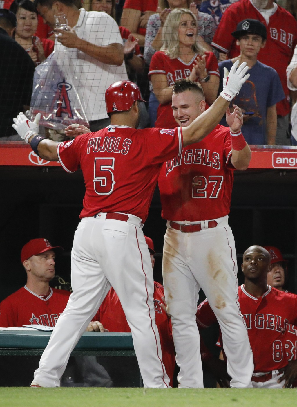 Los Angeles Angels' Albert Pujols, left, celebrates his second home run of the night with Mike Trout during the sixth inning of the team's baseball ga