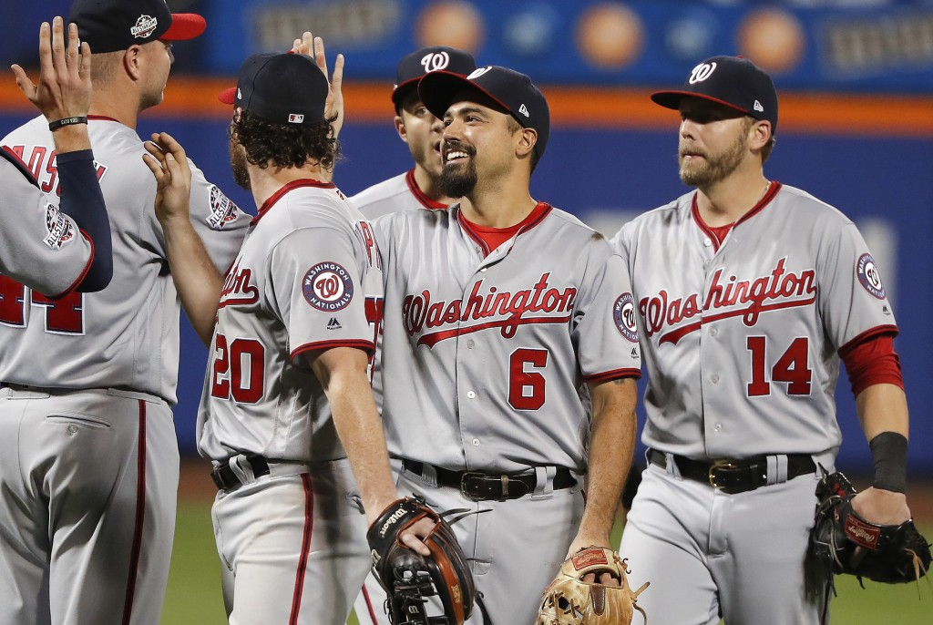The Washington Nationals celebrate after defeating the New York Mets 5-4 in a baseball game Thursday, July 12, 2018, in New York. (AP Photo/Julie Jaco