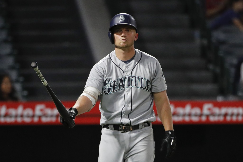 Seattle Mariners' Kyle Seager reacts after striking out during the eighth inning of the team's baseball game against the Los Angeles Angels, Thursday,