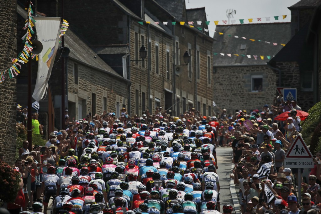 The pack rides during the seventh stage of the Tour de France cycling race over 231 kilometers (143.5 miles) with start in Fougeres and finish in Char