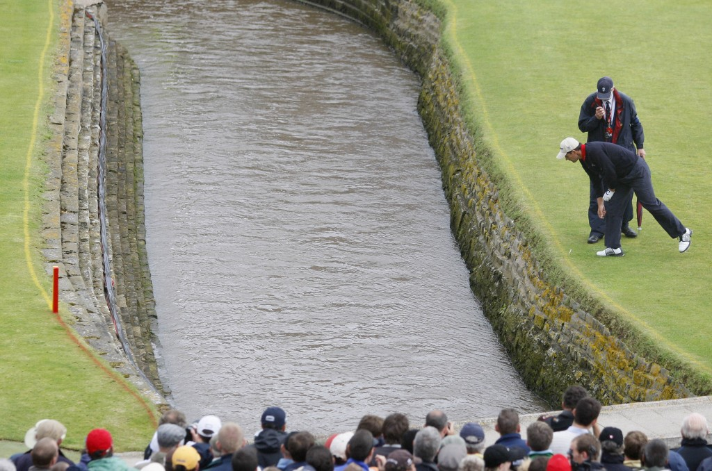 FILE - In this July 22, 2007, file photo, Ireland's Padraig Harrington looks down to where his ball landed in the Barry Burn during the final round of