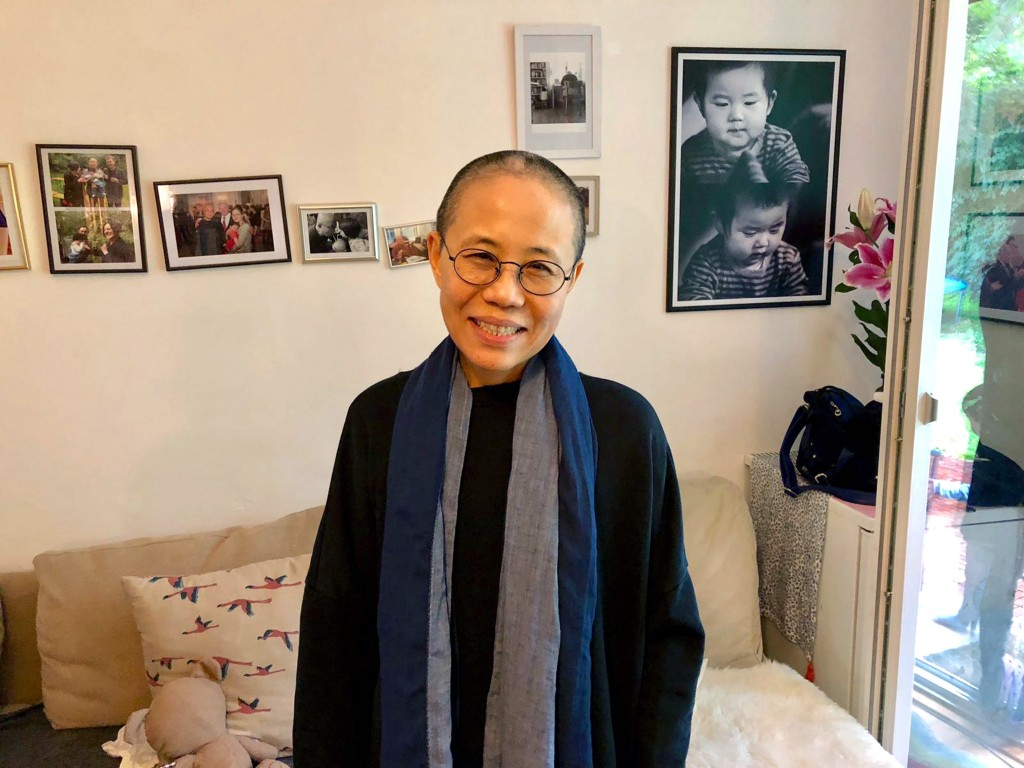 In this July 12, 2018, photo provided on July 13, 2018, by Tienchi Martin-Liao, Liu Xia, the widow of Nobel Peace Prize laureate Liu Xiaobo, stands in
