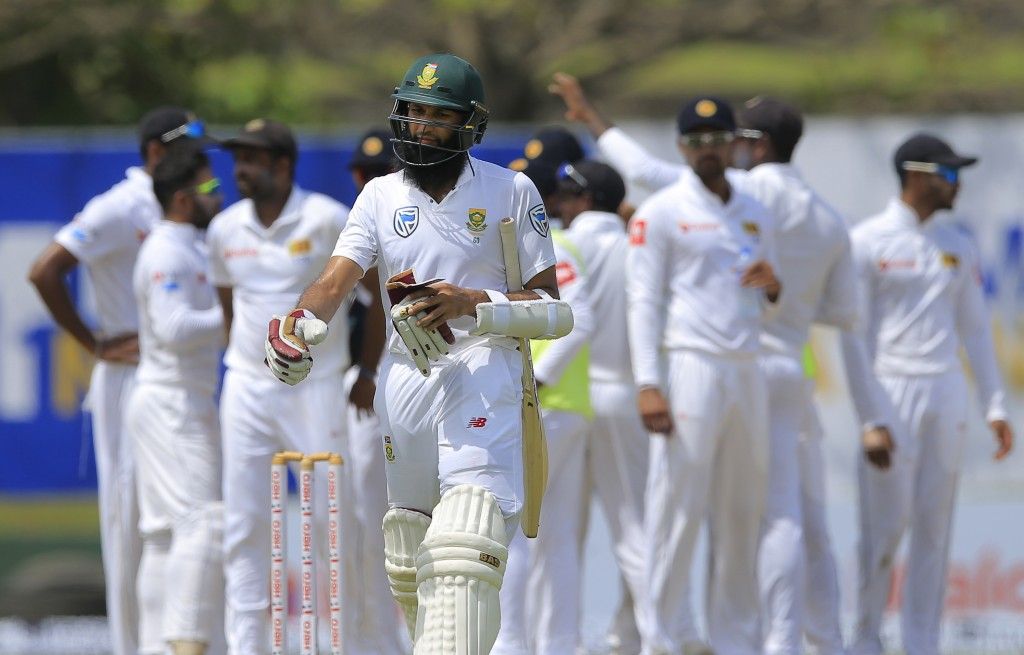South Africa's Hashim Amla reacts as he leaves the ground after losing his wicket during the second day of their first test cricket match against Sri