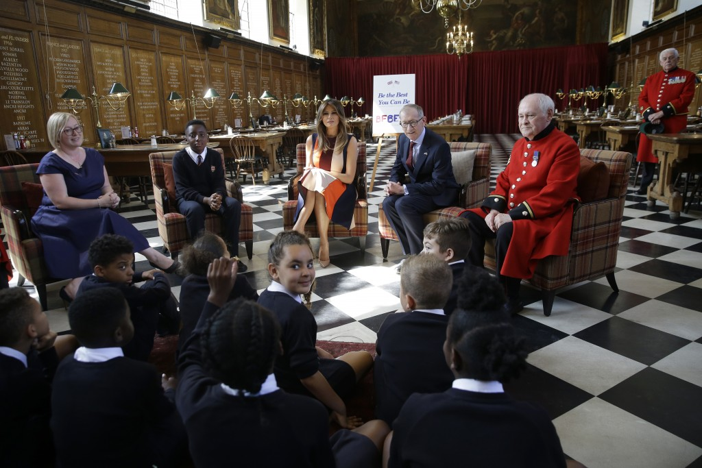 "U.S. First Lady Melania Trump, takes questions from school children as she meets British military veterans known as ""Chelsea Pensioners"" at The Royal"