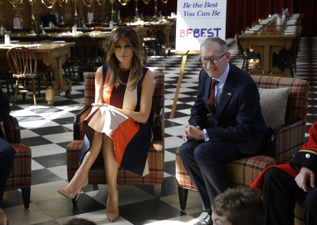 Philip May, the husband of British Prime Minister Theresa May, right, and U.S. First Lady Melania Trump take questions from school children as they me