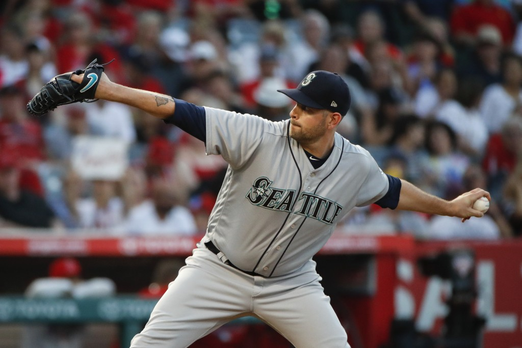 Seattle Mariners starting pitcher James Paxton throws to a Los Angeles Angels batter during the first inning of a baseball game Thursday, July 12, 201