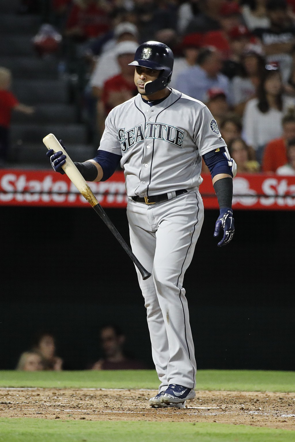 Seattle Mariners' Nelson Cruz heads back to the dugout after striking out during the fourth inning of the team's baseball game against the Los Angeles