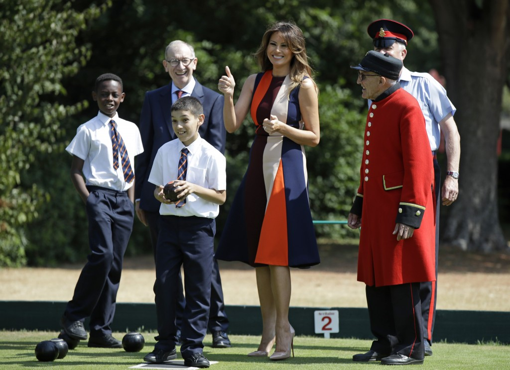 U.S. First Lady Melania Trump gestures as she plays bowls with Philip May, the husband of British Prime Minister Theresa May during a visit to British