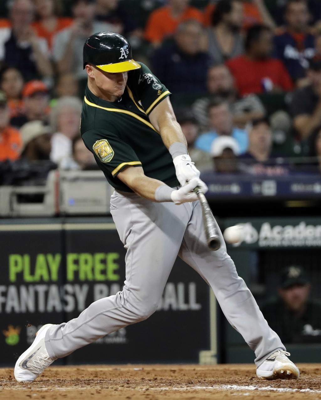 Oakland Athletics' Matt Chapman hits a RBI double during the eighth inning of a baseball game against the Houston Astros Thursday, July 12, 2018, in H