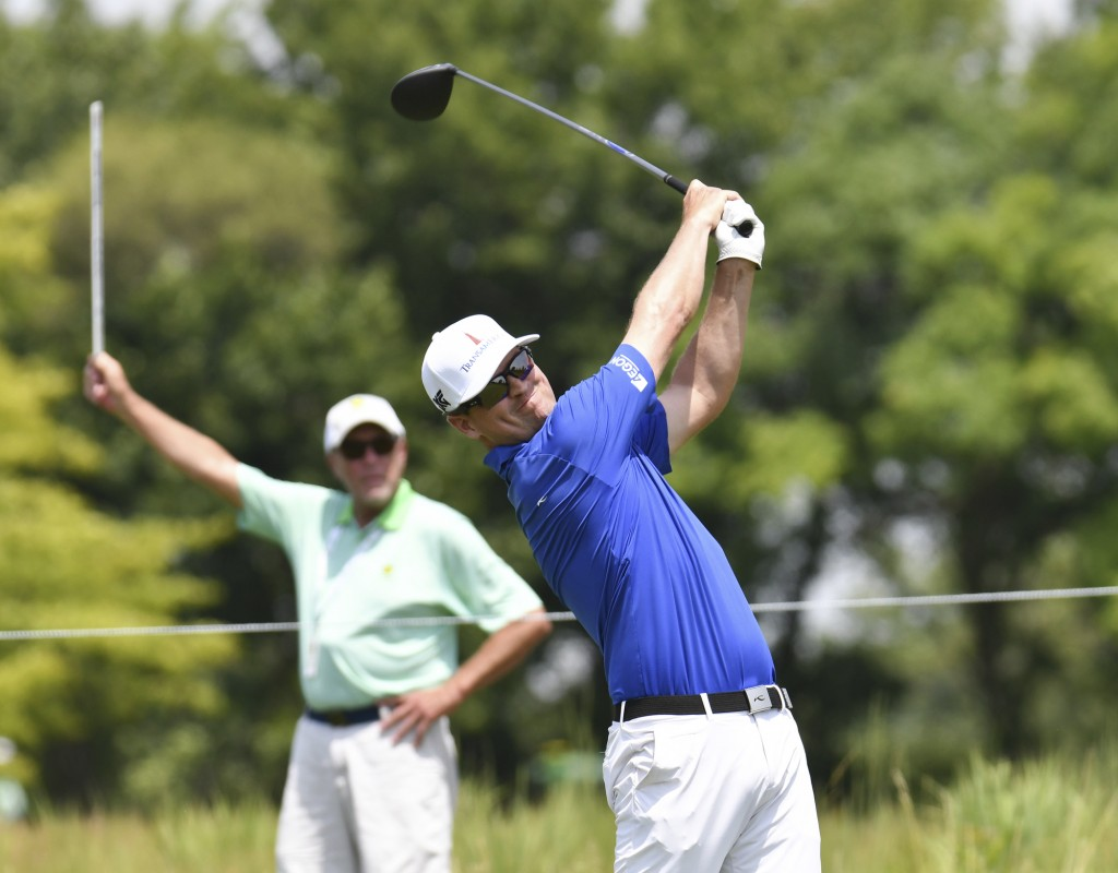 Zach Johnson tees off on the ninth hole during the first-round of the John Deere Classic golf tournament Thursday, July 12, 2018, in Silvis, Ill. (Tod