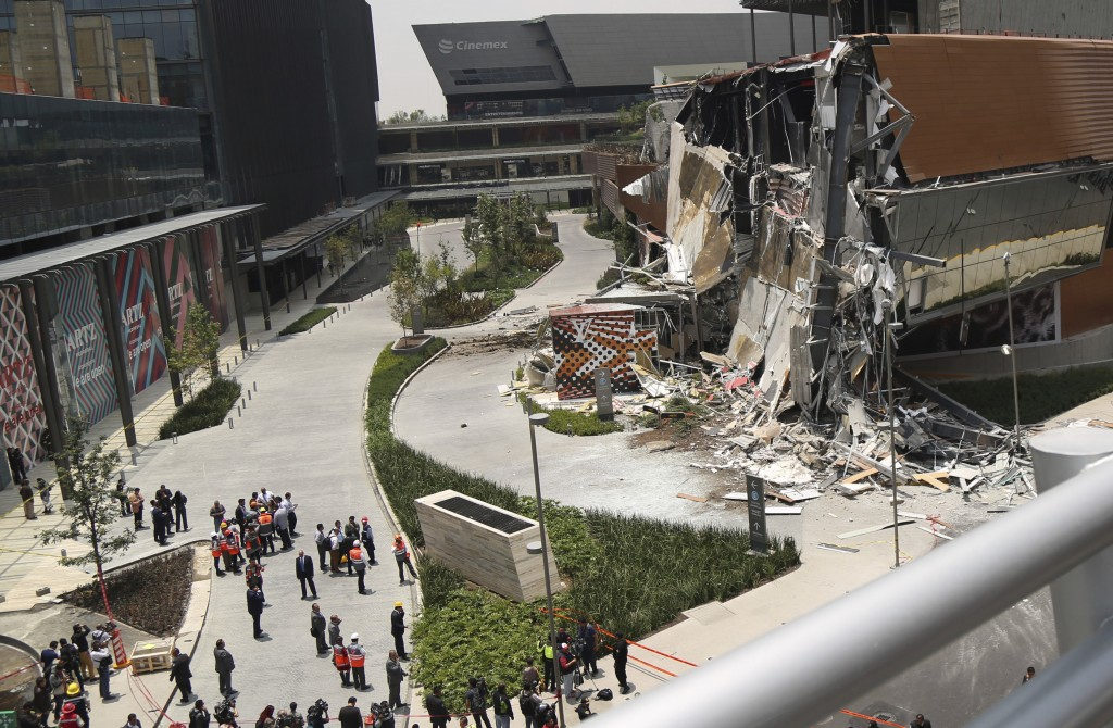 The Artz Pedregal shopping mall stands partially collapsed on the south side of Mexico City, Thursday, July 12, 2018. The newly opened shopping mall p