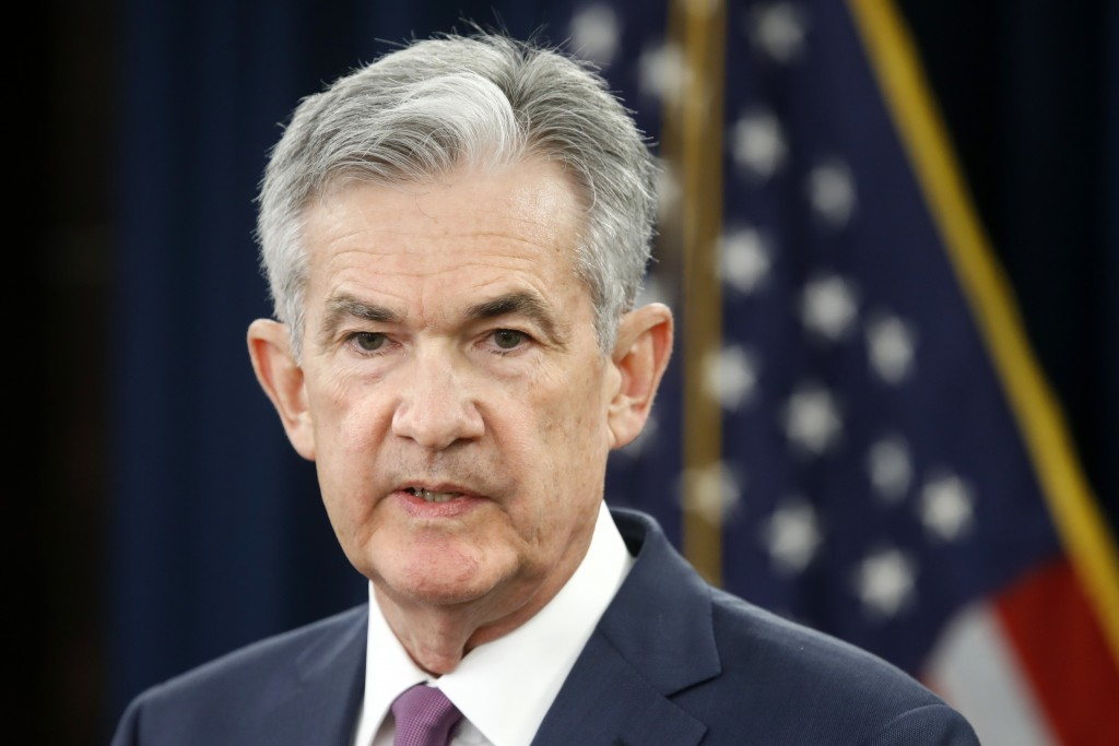 FILE- In this June 13, 2018, file photo, Federal Reserve Chair Jerome Powell speaks to the media after the Federal Open Market Committee meeting in Wa