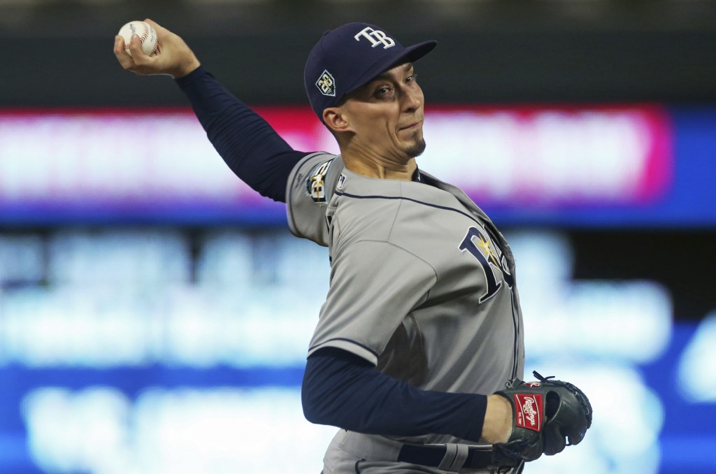 Tampa Bay Rays pitcher Blake Snell throws to a Minnesota Twins batter during the first inning of a baseball game Thursday, July 12, 2018, in Minneapol