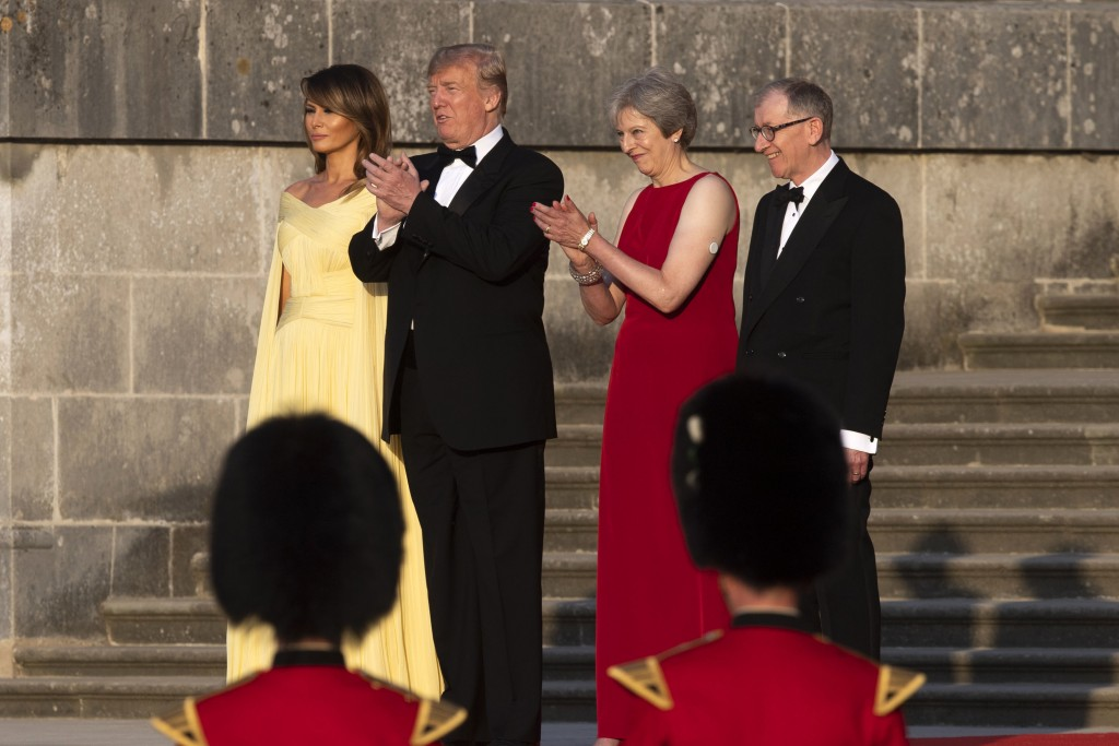From left, first lady Melania Trump, President Donald Trump, British Prime Minister Theresa May, and her husband Philip May, watch the arrival ceremon