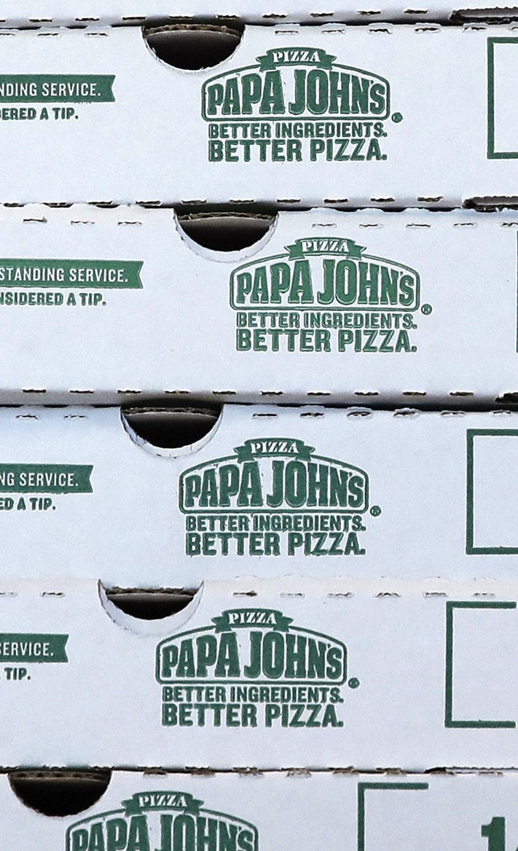 FILE- This Dec. 21, 2017, file photo shows pizza boxes stacked at a Papa John's pizza store in Quincy, Mass. Papa John's plans to pull founder John Sc