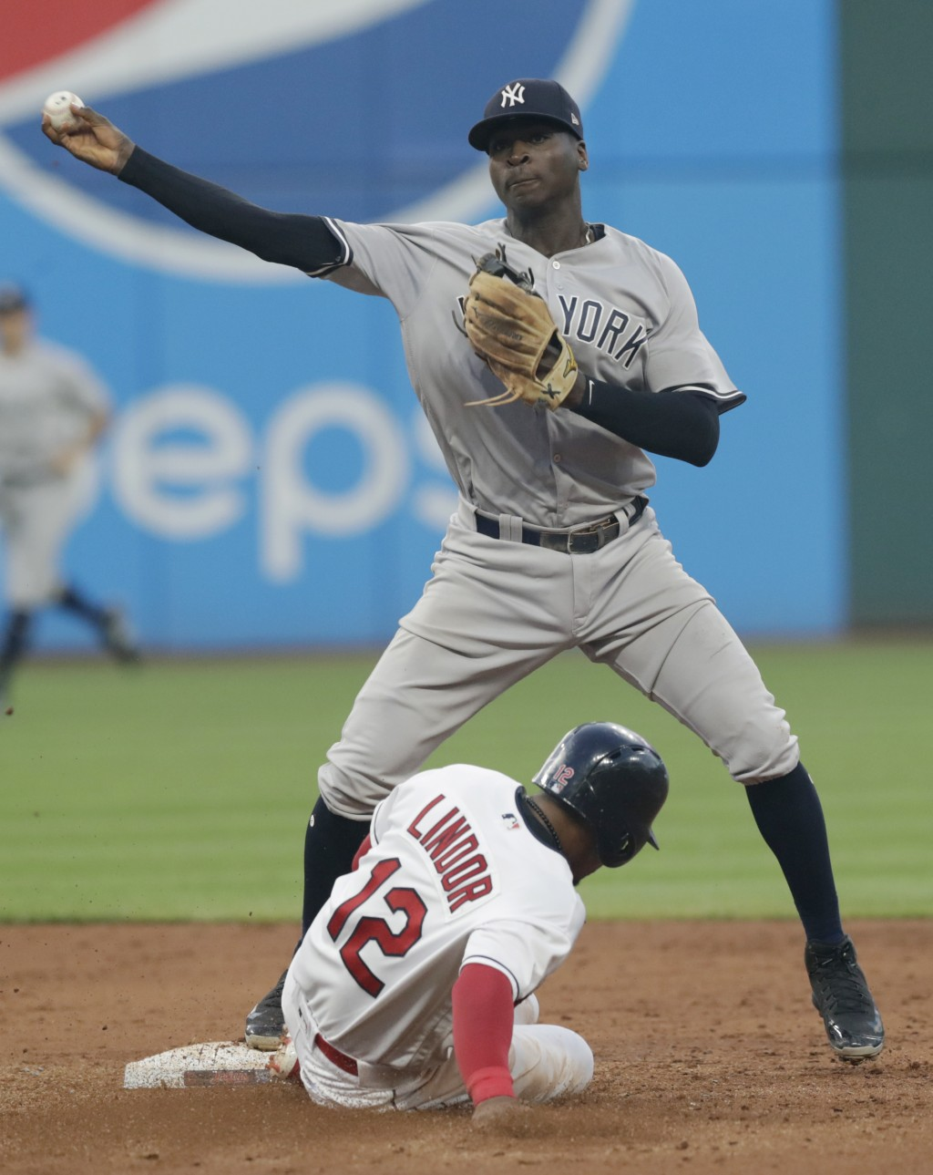 New York Yankees' Didi Gregorius throws to first base after getting Cleveland Indians' Francisco Lindor out at second base during the fifth inning of