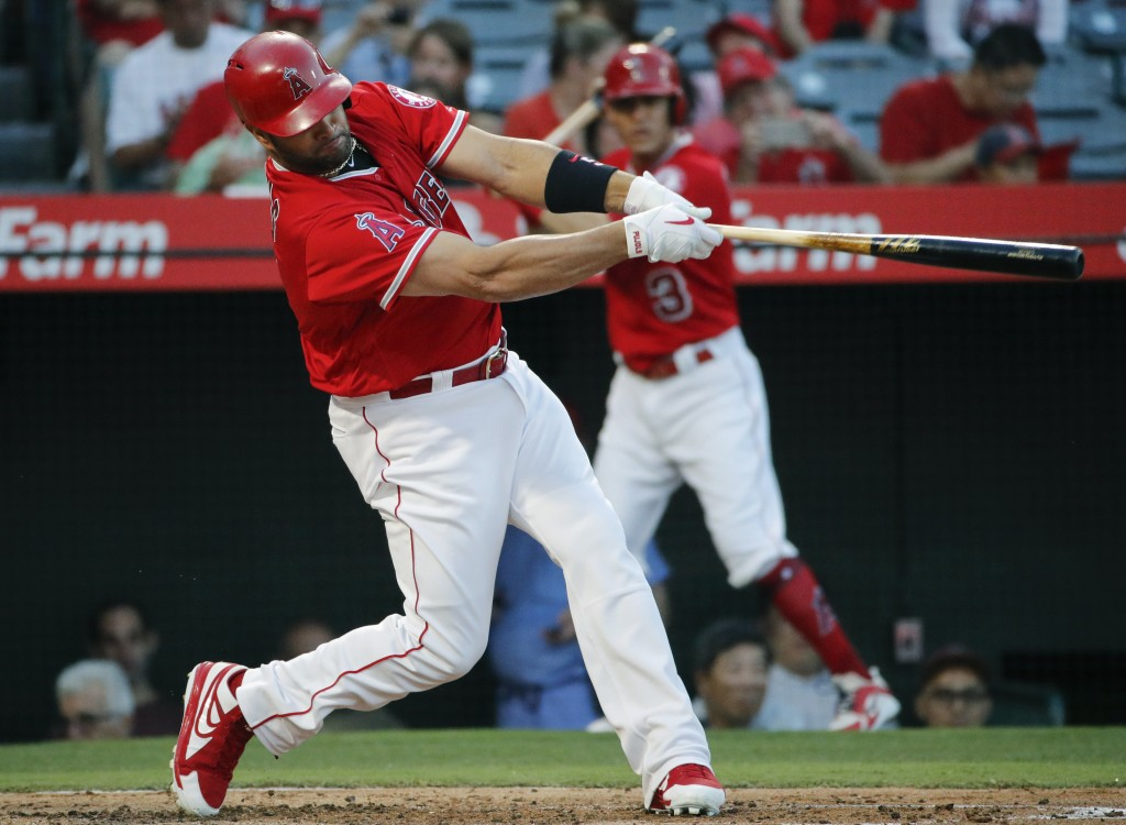 Los Angeles Angels' Albert Pujols hits a two-run home run during the first inning of the team's baseball game against the Seattle Mariners, Thursday,