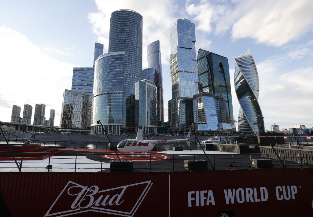 In this July 5, 2018 photo, a helicopter sits atop the Budweiser boat, parked on the Moskva River during the 2018 soccer World Cup in Moscow, Russia.