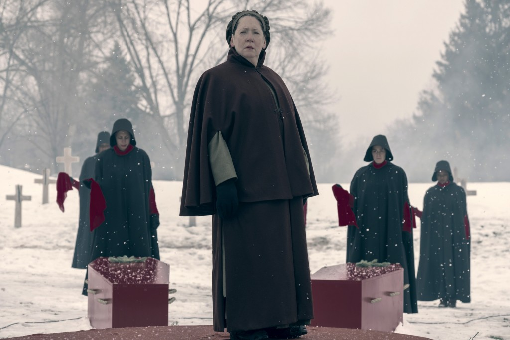 "This image released by Hulu shows Ann Dowd in a scene from ""The Handmaid's Tale."" Dowd was nominated Thursday for an Emmy for outstanding supporting a"