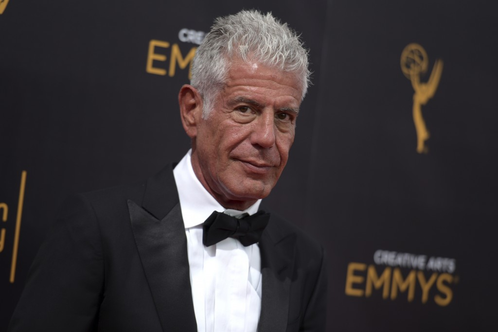 FILE - In this Sept. 11, 2016 file photo, Anthony Bourdain arrives at night two of the Creative Arts Emmy Awards in Los Angeles. Bourdain, who took hi