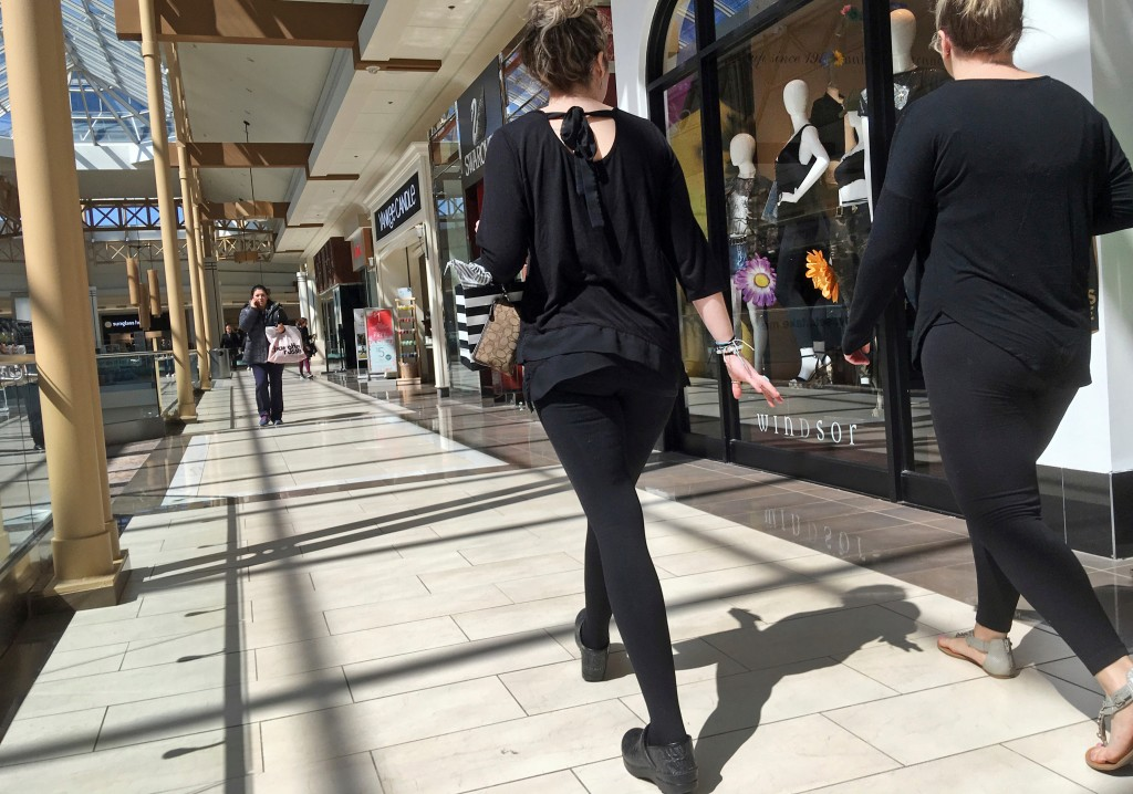 FILE- In this April 9, 2018, file photo, shoppers walk in a mall in Salem, N.H. As Amazon gears up for its Prime Day promotion, other big-name retaile