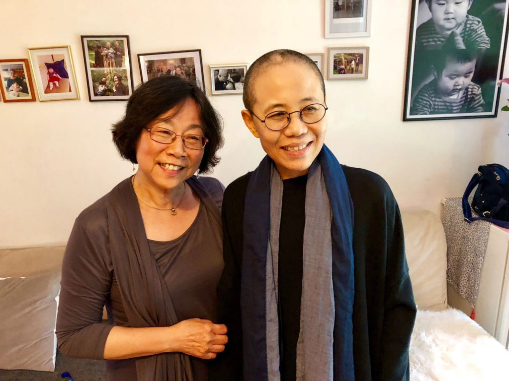 In this Thursday, July 12, 2018, photo provided Friday, July 13, 2018, by Tienchi Martin-Liao, Liu Xia, right, the widow of Nobel Peace Prize laureate