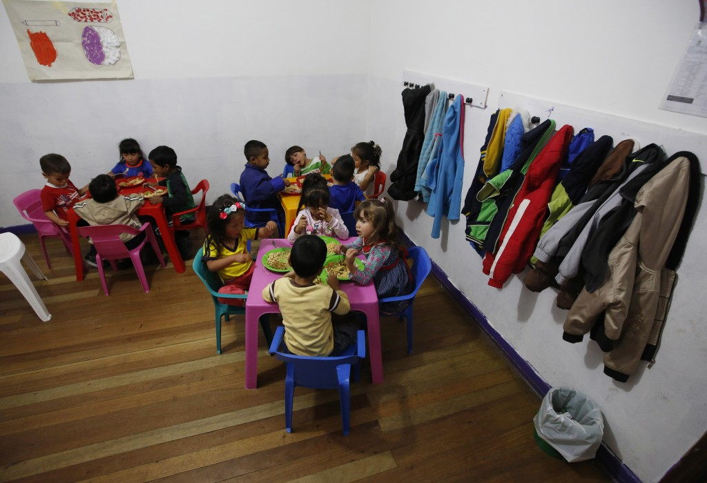 This July 4, 2018 photo shows children, some of whom are Venezuelan migrants, eating lunch at the child development center Social Foundation Grow wher